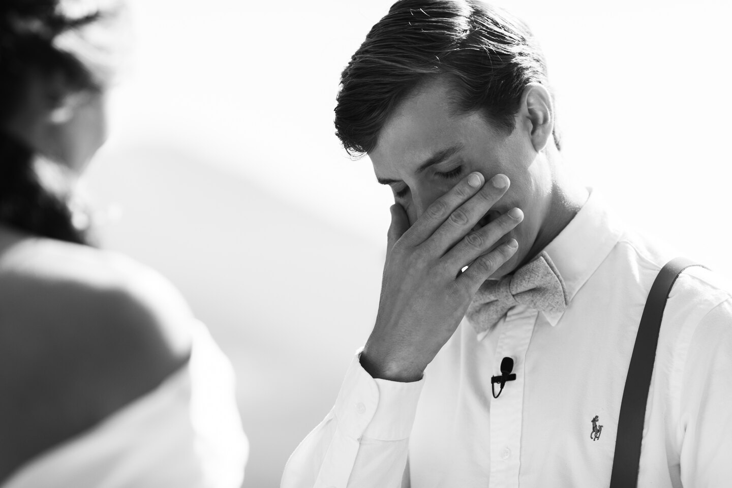 Wedding Photographer in Italy: The moment where the groom did not hold back the emotions from the words of the vow to his beloved and wipes the tears from his face