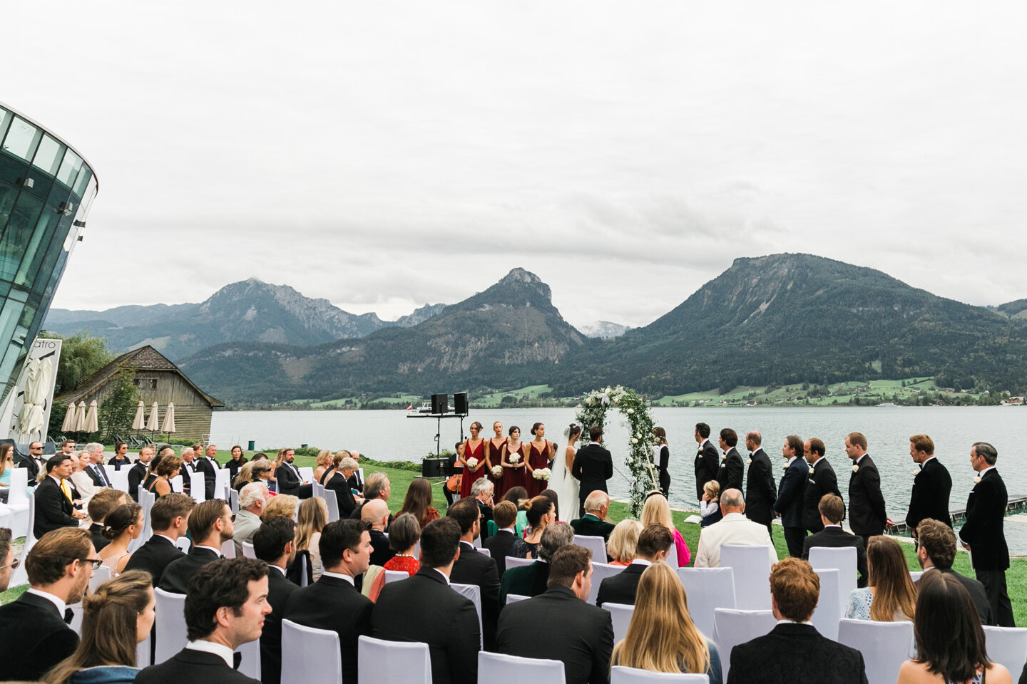 Wedding Photographer in Milan: Wedding ceremony at a luxurious estate overlooking a mountain lake and mountains