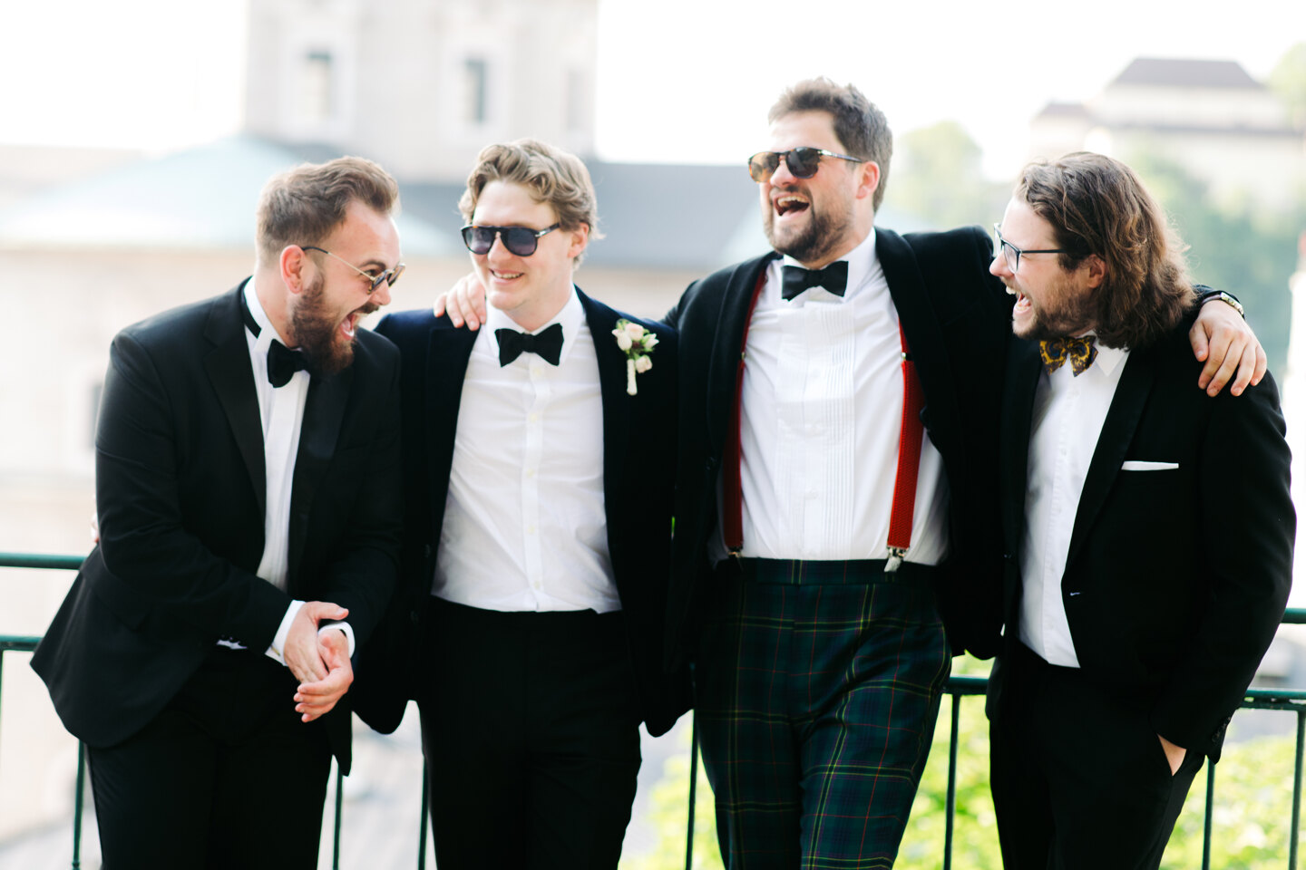 Services of Wedding Photographer in Italy: Groom and his friends have fun chatting on the balcony
