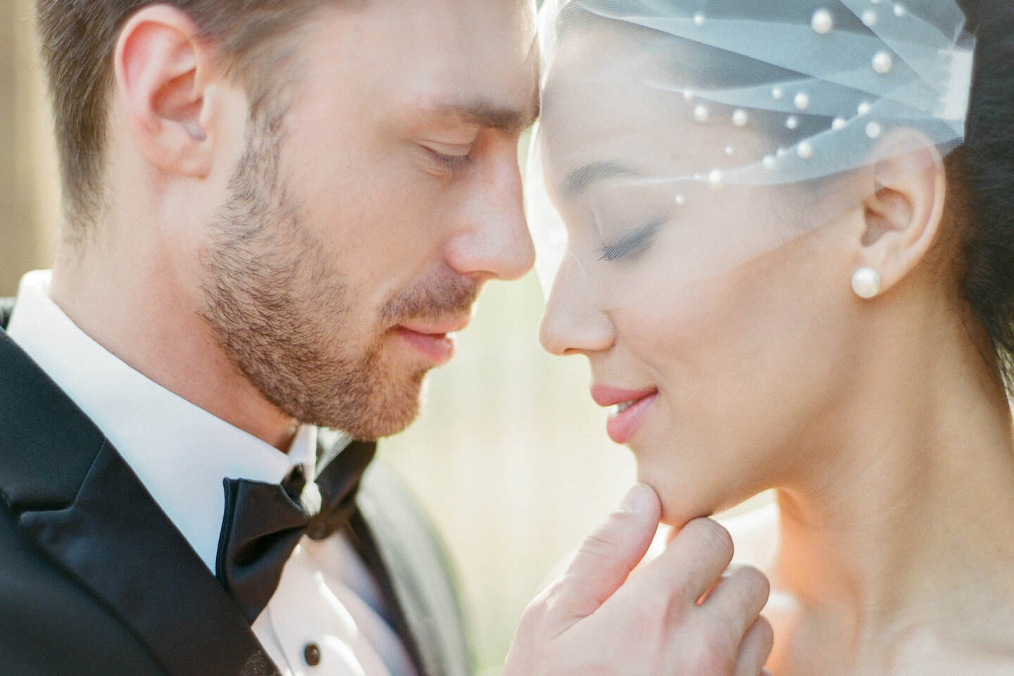 Services of Wedding Photographer in Italy: Portrait of a couple where the groom gently touches his beloved chin, showing his love and care