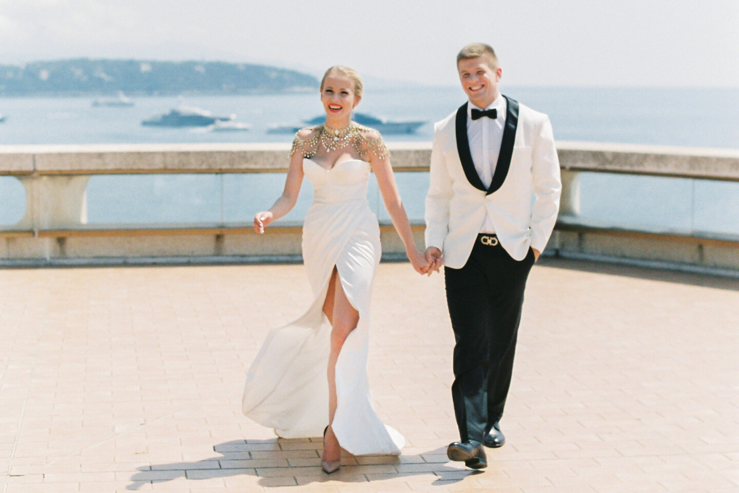 Couple photoshoot in Italy: A happy couple of newlyweds, boldly steps forward holding hands